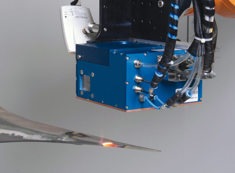 "Dynamic beam shaping unit ""LASSY"" during a laser beam hardening process, mounted to a roboter"